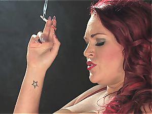 redhead slut dominates a dude while smoking