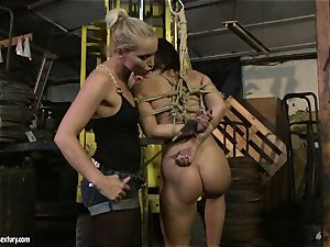 Kathia Nobili smacking the caboose of scorching girl with whip