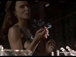 brown-haired Lena Olin in undergarments showcases off her small bumpers