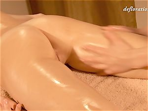 Elena being lube caressed by another woman