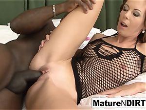 dark-haired milf masturbates before taking a big black cock