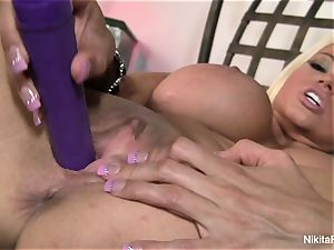 sizzling blonde Nikita plays with a purple toy